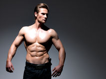 Handsome man with muscular beautiful body. Stock Image