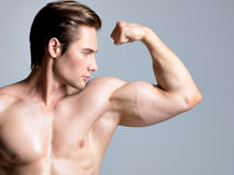 Handsome man with muscular beautiful body. Royalty Free Stock Photography