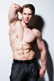 Handsome man with sexy muscular body. Stock Photo
