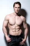 Handsome man with sexy muscular body. Stock Images