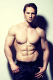 Handsome man with sexy muscular body. Royalty Free Stock Photos
