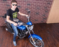 Handsome Man with Shades on his Motorcycle Stock Image
