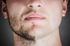 Handsome man with a shaved half his face Stock Photos