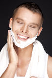 Handsome man shaves Royalty Free Stock Images
