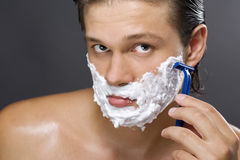Handsome Man Shaving Stock Image