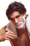 Handsome man shaving. Handsome man portrait while shaving in the morning. Studio shot Stock Image
