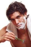 Handsome man shaving Stock Image