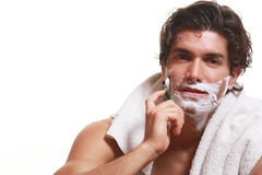 Handsome man shaving Stock Photos