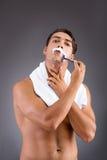 The handsome man shaving against dark background Stock Photo