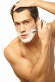 Handsome Man Shaving As Part Of Morning Routine Royalty Free Stock Photos