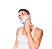 Handsome man with shaving cream Royalty Free Stock Images