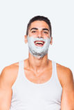 Handsome man with shaving cream Stock Photography