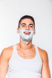 Handsome man with shaving cream Royalty Free Stock Image