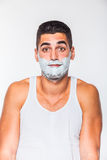 Handsome man with shaving cream Stock Images