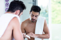 Handsome man shaving his beard. In bathroom Stock Images