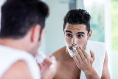 Handsome man shaving his beard Stock Photography