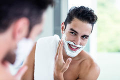 Handsome man shaving his beard Royalty Free Stock Photos
