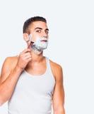 Handsome man shaving his beard Royalty Free Stock Photo