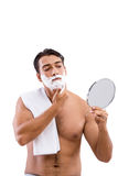 The handsome man shaving isolated on white Stock Images
