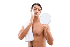 The handsome man shaving isolated on white Stock Photo