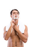 The handsome man shaving isolated on white Royalty Free Stock Image