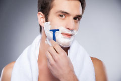Handsome man shaving. Royalty Free Stock Photo