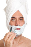 Handsome man shaving Royalty Free Stock Photography