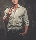 Handsome man in shirt against grunge wall Stock Photo
