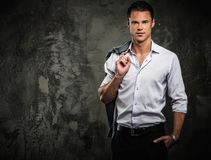 Handsome man in shirt against grunge wall Royalty Free Stock Photos