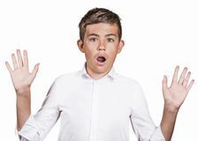 Handsome man shocked surprised in disbelief hands raised Stock Images