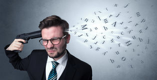 Handsome man shooting his head with gun Royalty Free Stock Images