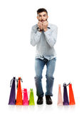 Handsome man with shopping bags is shocked Stock Image