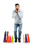 Handsome man with shopping bags is shocked Stock Images
