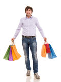 Handsome man with shopping bags Stock Photo