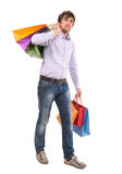 Handsome man with shopping bags Stock Photography