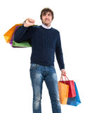 Handsome man with shopping bags Royalty Free Stock Image
