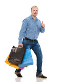 Handsome man with shopping bags Stock Photos