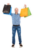 Handsome man with shopping bags Royalty Free Stock Photography