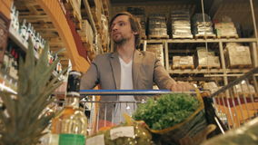 Handsome Man Shopping In A Supermarket, View From Shopping Trolley stock video footage