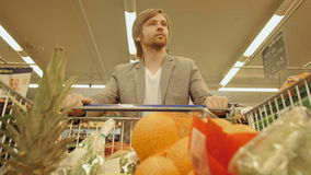 Handsome Man Shopping In A Supermarket, View From Shopping Trolley stock video