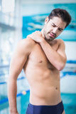 Handsome man with shoulder ache Royalty Free Stock Photography