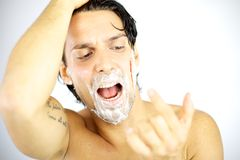 Handsome man shouting with blood on his face Stock Photography