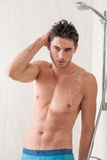 Handsome man in shower Stock Images