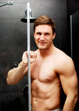 Handsome man at the shower. Royalty Free Stock Photography