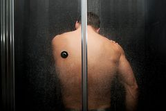 Handsome man at the shower. Royalty Free Stock Image