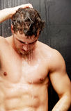Handsome man at the shower. Stock Photo