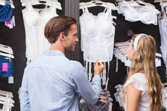 Handsome man showing bodice to his girlfriend Stock Images