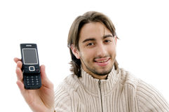 Handsome man showing cell phone Stock Photography