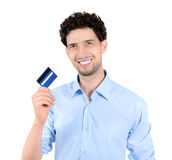 Handsome man showing credit card isolated Stock Photography