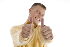 Handsome man showing good luck Stock Images